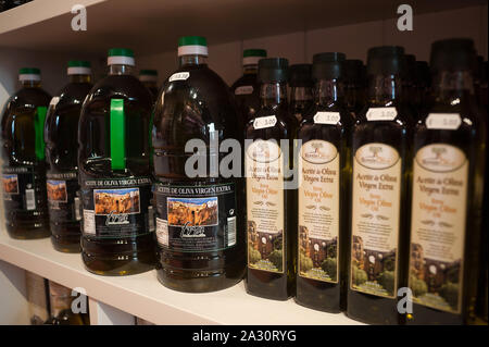 Bottles of virgin extra olive oil are seen displayed inside a food store.U.S president Donald Trump, announced that he will impose tariffs to different Spanish products as virgin olive oil, ham, olives, wine or cheese and will increase the price on 25% of sales in US. The agri-food production of traditional products exported from Andalusia to U.S is one the most important of Spain with a high economic impact in the Andalusia province. - Stock Photo