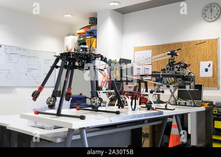 Research and development drone laboratory. View of an indoor workshop with multiple kinds of UAV - Stock Photo