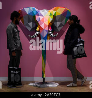 London, UK.  4 October 2019. Visitors view 'Elefunk', 2019, by Okuda San Miguel at Moniker International Art Fair, an urban contemporary art fair celebrating its 10 year anniversary in the UK.  The fair is on at Chelsea's Sorting Office until 6 October 2019.    Credit: Stephen Chung / Alamy Live News - Stock Photo