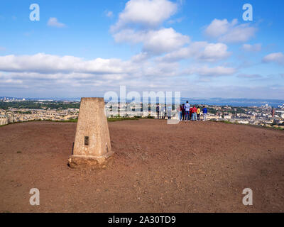 Visitors admiring the view over Edinburgh to the Firth of Forth from the trig point on Calton Hill Edinburgh Scotland - Stock Photo