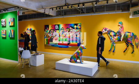 London, UK.  4 October 2019. Colourful works by Okuda San Miguel on display at Moniker International Art Fair, an urban contemporary art fair celebrating its 10 year anniversary in the UK.  The fair is on at Chelsea's Sorting Office until 6 October 2019.    Credit: Stephen Chung / Alamy Live News - Stock Photo