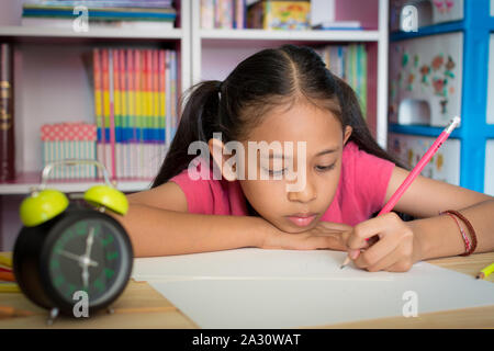 Little girl drawing on table at home, Education concept. - Stock Photo