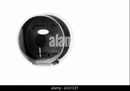 Black Bathroom Tissue Jumbo Dispenser Plastic mounted on wall 9 inche - Stock Photo