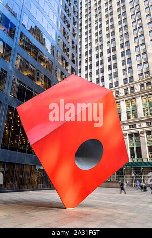 Isamu Noguchi's iconic sculpture Red Cube in Lower Manhattan, New York City, USA. - Stock Photo