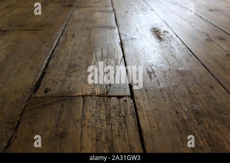Old elm floorboards, repaired and restored, in a listed building. - Stock Photo