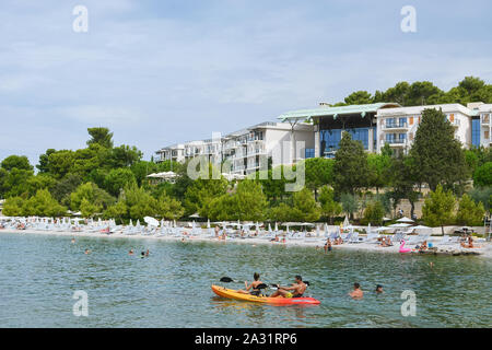 Rovinj, Croatia, August 22: Citizens and tourists sunbathe on Mulini beach and swim in the clear waters of the Adriatic on a bright Sunny day, August - Stock Photo