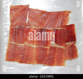 Spanish hamon, hand-sliced on a tray - Stock Photo