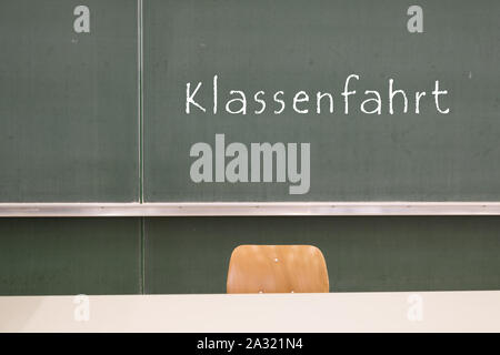Word class trip at the blackboard - Stock Photo