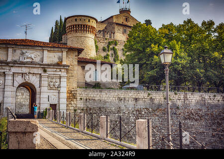 Medieval castle of Brescia city with a winged lion that holds a book. - Stock Photo