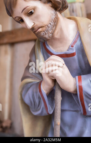 St. Joseph wooden statue in a traditional Italian Christmas crib. Close up. - Stock Photo