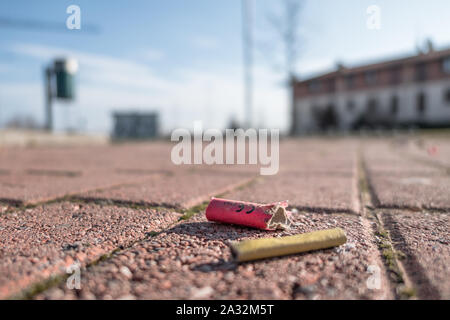 Old firecrackers exploded on the ground. Selected focus. - Stock Photo