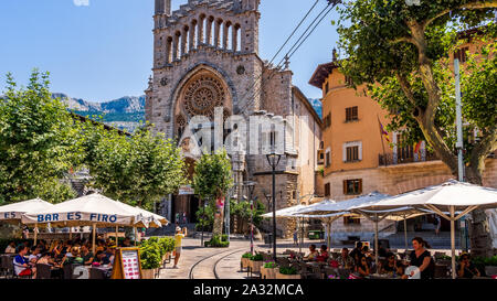 Soller, Mallorca, Spain, July 2015 St Bartholomew church and city square with vintage tramline and restaurants in Soler - Stock Photo