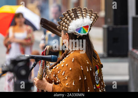 This middle aged Native American woman is wearing a formal ...