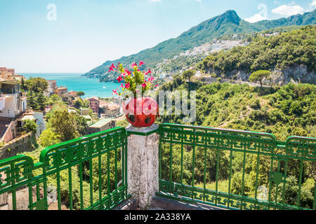 Vietri sul Mare, Amalfi coast picturesque Summer view on colorful ceramic flower pot, mountains and sea on sunny day - Stock Photo