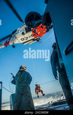 191002-N-NT795-411 SAN DIEGO (Oct. 2, 2019) Sailors assigned to Coastal Riverine Squadron 3 and Coast Guardsmen from U.S. Coast Guard Sector San Diego, conduct a joint medical evacuation exercise aboard a Mark VI patrol boat as part of unit level training provided by Coastal Riverine Group 1 Training and Evaluation Unit. The Coastal Riverine Force is a core Navy capability that provides port and harbor security, high value asset security, and maritime security operation in the coastal and inland waterways. (U.S. Navy photo by Chief Boatswain's Mate Nelson Doromal Jr) - Stock Photo