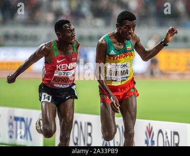 Doha, Qatar. 04th Oct, 2019. Conseslus Kipruto of Kenya and Lamche Girma of Ethiopia race at the finishing line in the 3000m steeplechase on day 8 of the 17th IAAF World Athletics Championships 2019, Kalifa International Stadium. Credit: SOPA Images Limited/Alamy Live News - Stock Photo
