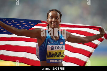Doha, Qatar. 04th Oct, 2019. Dalilah Muhammad of the USA celebrating her win and new world record in the 400m Hurdles final on day 8 of the 17th IAAF World Athletics Championships Doha 2019 at Khalifa International Stadium. Credit: SOPA Images Limited/Alamy Live News - Stock Photo