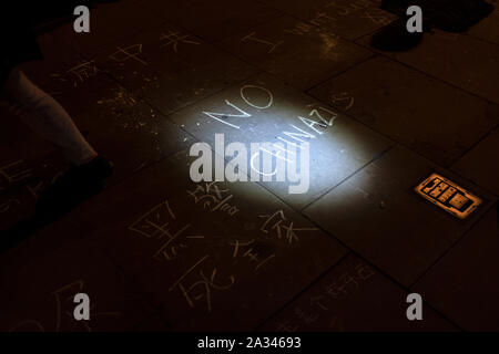 London, UK. 04th Oct, 2019. Protesters wrote on the pavement during the demonstration.Protesters rallied at Trafalgar Square to demand for democracy and justice in Hong Kong and protesting against the implementation of new laws by the Hong Kong government that forbidden to wear masks to protesters in a public protest. Credit: SOPA Images Limited/Alamy Live News - Stock Photo