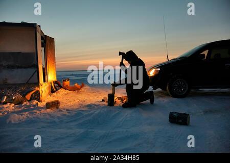 Russia Yakutsk Lena  Simeon Jegorov (53)  fishing on Ice with car and small house -45 degrees celcius  3-02-2013 photo: Jaco Klamer - Stock Photo
