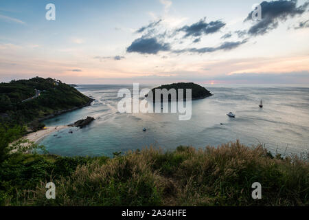 Tropical ocean landscape with a little island under dramatic blue sky, Phuket, Thailand - Stock Photo