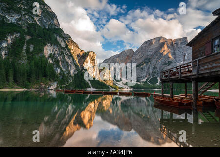 lonely child with red jacket on Lake Prags, Italy - Stock Photo