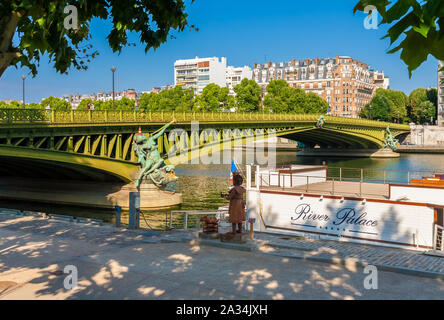 Lovely view of the Pont Mirabeau with the allegorical statue 'Abundance' from the Port de Javel Haut in Paris, France. The arch bridge spans the Seine... - Stock Photo