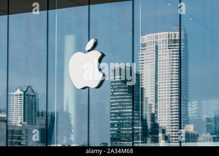 Logo of Apple Inc. on a Apple store in Iconsiam shopping mall in Bangkok, Thailand - Stock Photo