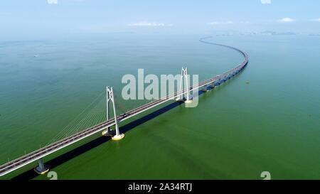 (191005) -- GUANGZHOU, Oct. 5, 2019 (Xinhua) -- Aerial photo taken on July 11, 2018 shows the Hong Kong-Zhuhai-Macao Bridge in south China. (Xinhua/Liang Xu)