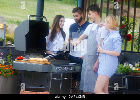 Young people at barbecues, Carlsbad, Czech Republic - Stock Photo