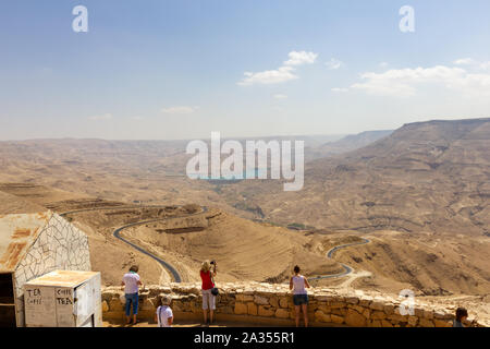 Wadi Mujib, Jordan - Sept 20, 2013: Tourists look over the Wadi Al Mujib valley with was formed in the last ice age. It's very impressive and also cal - Stock Photo