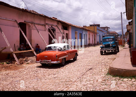 Classic car and an old truck in Trinidad, Cuba - Stock Photo