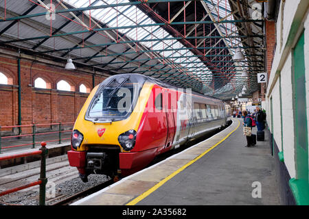 Virgin Class 221 Super Voyager at station about to take on passengers in Holyhead Wales. - Stock Photo