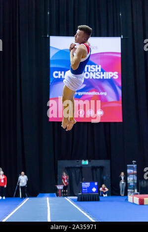 Birmingham, England, UK. 28 September 2019. Benjamin Goodall (OLGA Poole) in action during the Trampoline, Tumbling and DMT British Championship Qualifiers at the Arena Birmingham, Birmingham, UK. - Stock Photo
