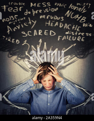 Scared teenager boy mess in head, hands covering ears, eyes closed feeling pain, headache and emotional stress. Anxiety, mental health problems, adole - Stock Photo