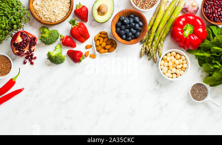 Healthy vegan food flat lay with copy space. Superfoods with micro greens on marble background - Stock Photo