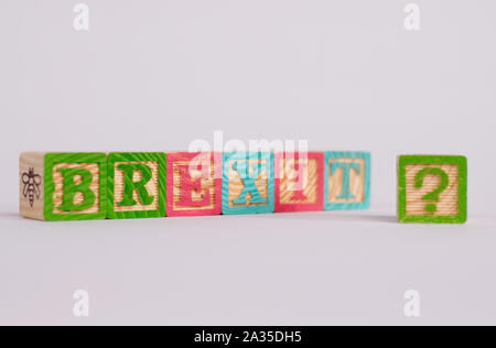 The word 'Brexit' in coloured wooden blocks, with a question mark on the right side. Taken in landscape mode, copy space available. - Stock Photo