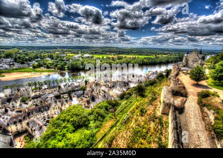 Chinon, France. Artistic view of the River Vienne at Chinon, with the Fortress Royal's preserved gable of the main room on the right of the image. - Stock Photo