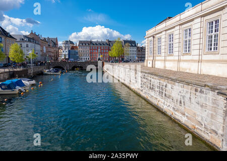 Copenhagen, Denmark - May 04, 2019: View of Canal with boats and Old bridge in the historical city centre of Copenhagen, Denmark