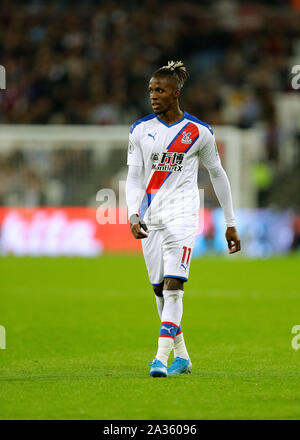London Stadium, London, UK. 5th Oct, 2019. English Premier League Football, West Ham United versus Crystal Palace; Wilfried Zaha of Crystal Palace - Strictly Editorial Use Only. No use with unauthorized audio, video, data, fixture lists, club/league logos or 'live' services. Online in-match use limited to 120 images, no video emulation. No use in betting, games or single club/league/player publications Credit: Action Plus Sports/Alamy Live News - Stock Photo