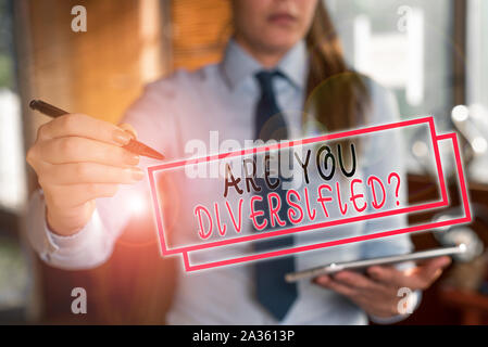Text sign showing Are You Diversified Question. Business photo text someone who is Different Mixed Multi Faceted Blurred woman in the background point - Stock Photo