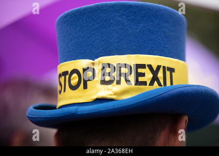 Well known blue hat from anti-Brexit protester Steve Bray seen on Parliament Square, London. - Stock Photo