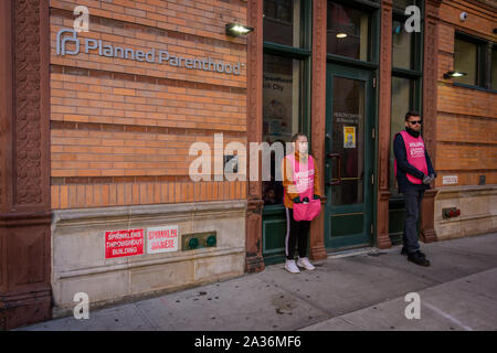New York, USA. 5th Oct, 2019. Two volunteers standing at the door of the Planned Parenthood offices in SoHo. Credit: Erik McGregor/ZUMA Wire/Alamy Live News - Stock Photo