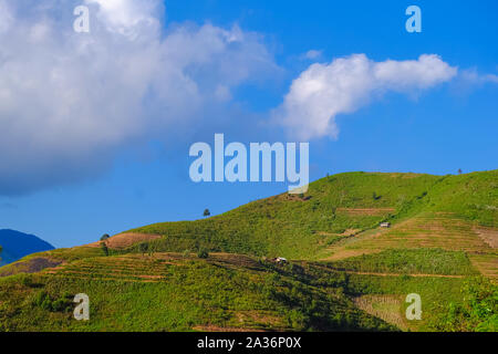 Beautiful landscape of mountain with cloud and blue sky in Ta Xua, Northwest Vietnam. Royalty high quality stock image of landscape, mountain. - Stock Photo