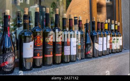 Tbilisi, Georgia - September 3, 2019: Bottles of Georgian wine in a store window. Georgian winemaking today - Stock Photo