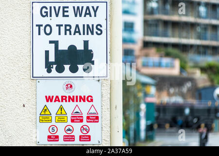 Give Way to Trains sign on Wapping Railway Wharf on Floating Harbour in Bristol, England, UK. - Stock Photo