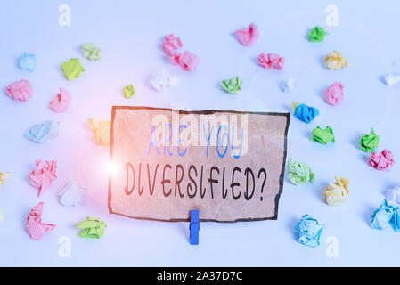 Text sign showing Are You Diversified Question. Business photo text someone who is Different Mixed Multi Faceted Colored crumpled papers empty reminde - Stock Photo