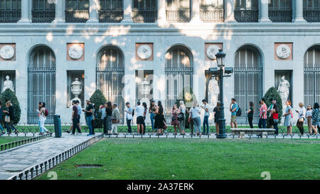 Madrid, Spain - Oct 5, 2019: Tourists queue at the entrance of the Prado Museum in Madrid, Spain. Over-tourism concept - Stock Photo