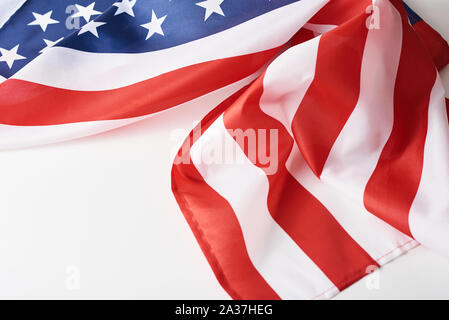 Close up of waving national usa american flag on white background with copy space. Concept of  4th of July or Memorial Day - Stock Photo