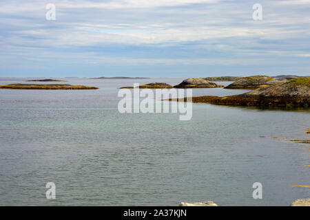 coastline view from atlantic road 64 in norway, view from the atlantic ocean road over calmy sea with little islands - Stock Photo