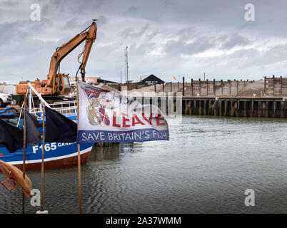 Whitstable fishing boat flying a protest flag on a damp dull day, which  represents the mood of the UK concerning the lack of progress with Brexit. - Stock Photo